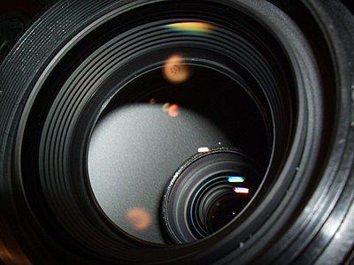 Two Grains Of White 'Dirt' behind actual XHA1 lens-dscf1342.jpg