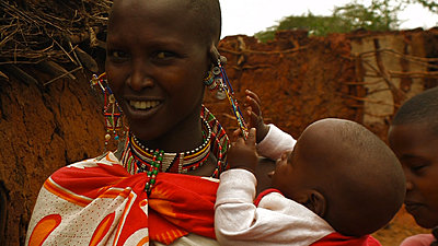 Tour To Africa-masai_woman_with_pulling_kid.jpg