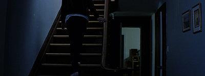 GH1 Feature film grabs (Anamorphic, 40Mbps hack)-jenn_walks_upstairs.jpg