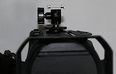 Sony FDR-AX100-cold-shoe-adapter-front-view.jpg