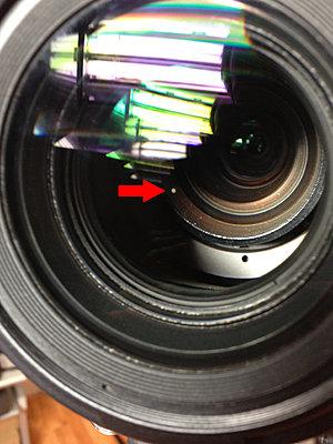 How do I clean internal lens element on EX1.  Sony Service sent back a drity lens.-ex1_spot.jpg