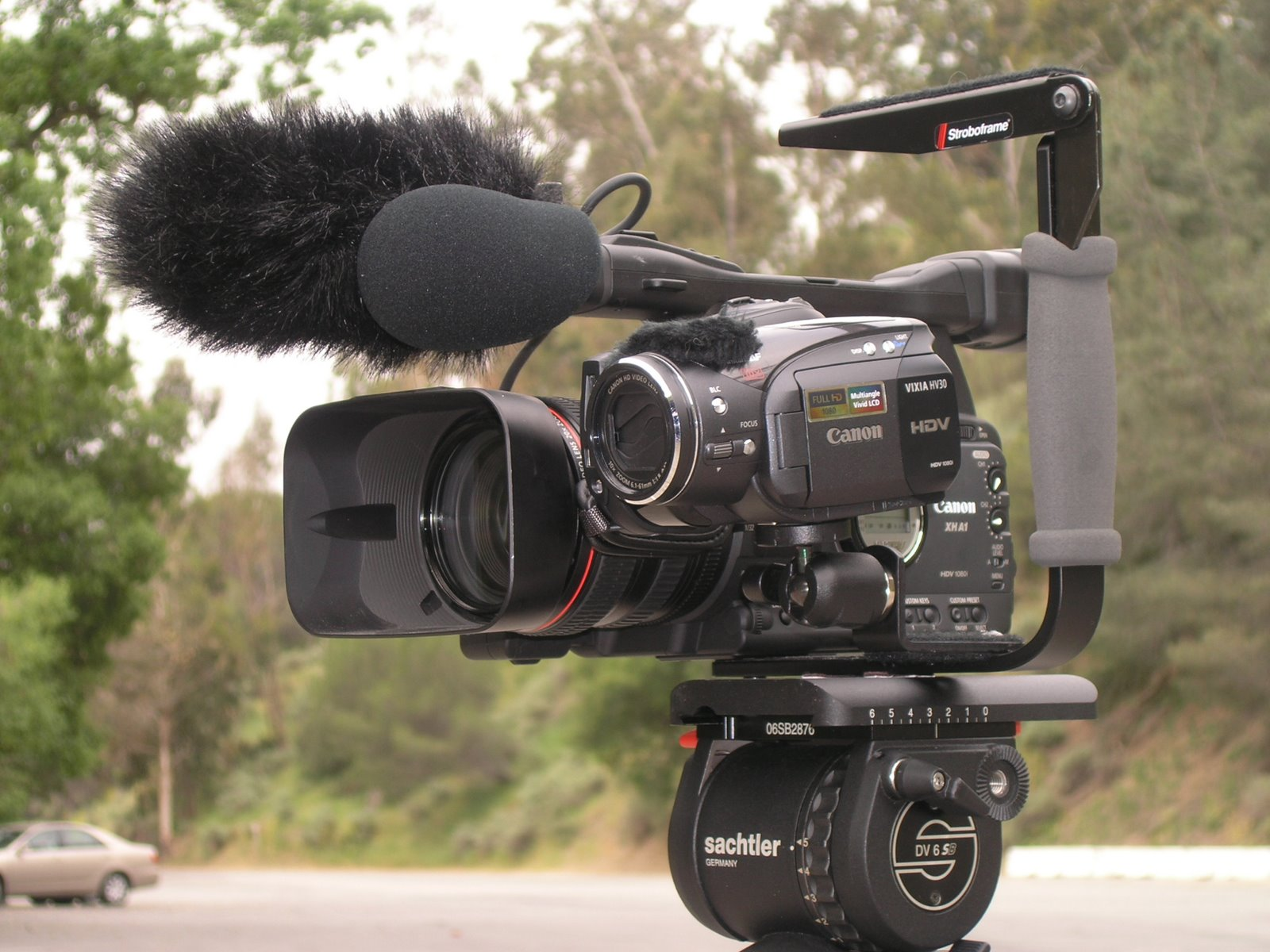 Tripod Head For Dual Video Cameras At