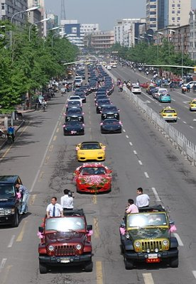 Parade of cars at Chinese Wedding-video-crew2.bmp