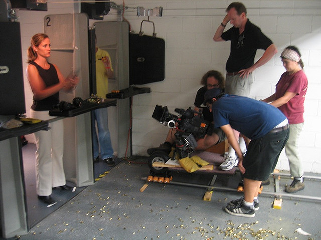 Chris Ward (standing, in black shirt) directs PERSON OF INTEREST.