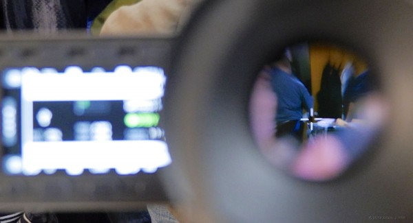 With an eye to the EVF, the LCD keeps camera menus available at a glance.