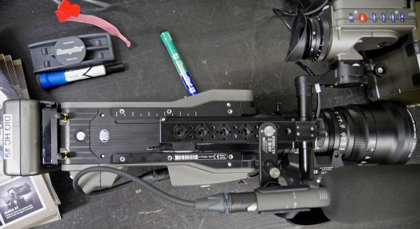 Top view: note the sculpted sides; I/O sockets placed so cables hug the camera body.