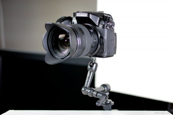 The GH4 is light enough to mount it on a magic arm.