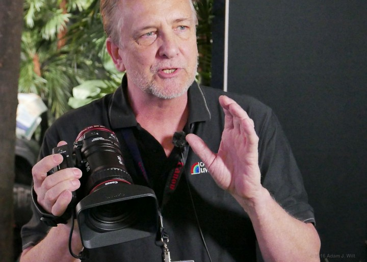 Canon's Brent Ramsey shows off the lens to the press
